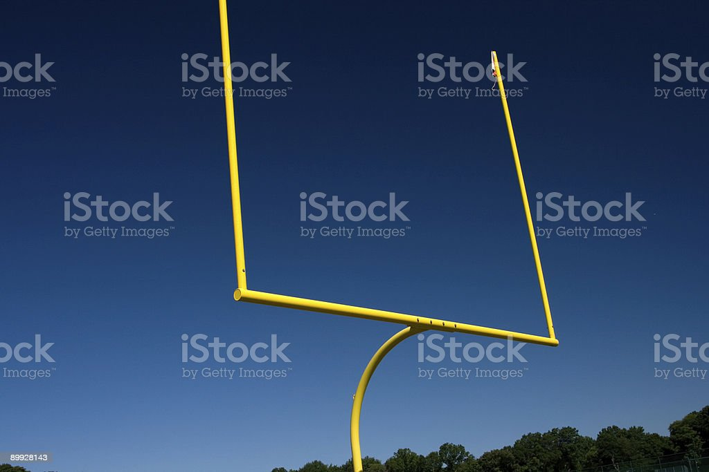 Yellow Field Goal Post Against a Deep Blue Clear Sky royalty-free stock photo