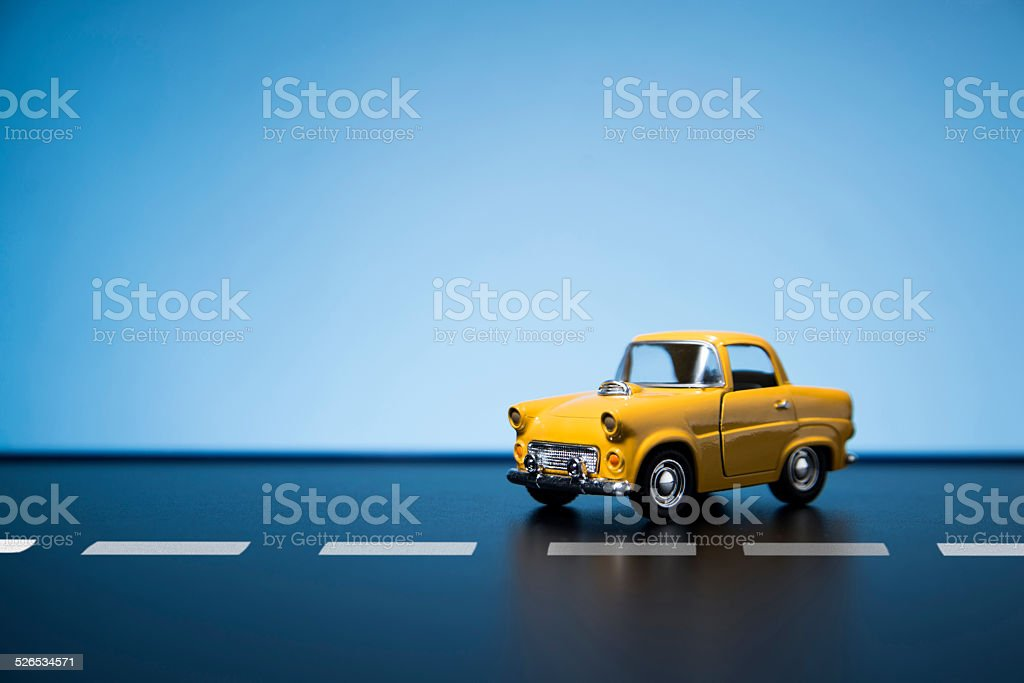 Yellow fifties toy model car. stock photo
