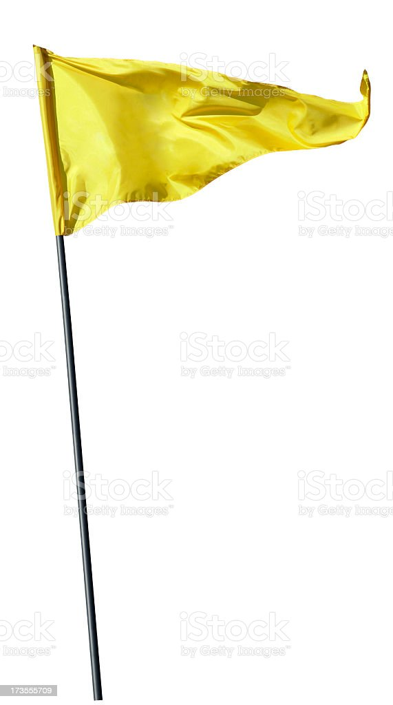 Yellow flag on flag pole blowing in the wind stock photo