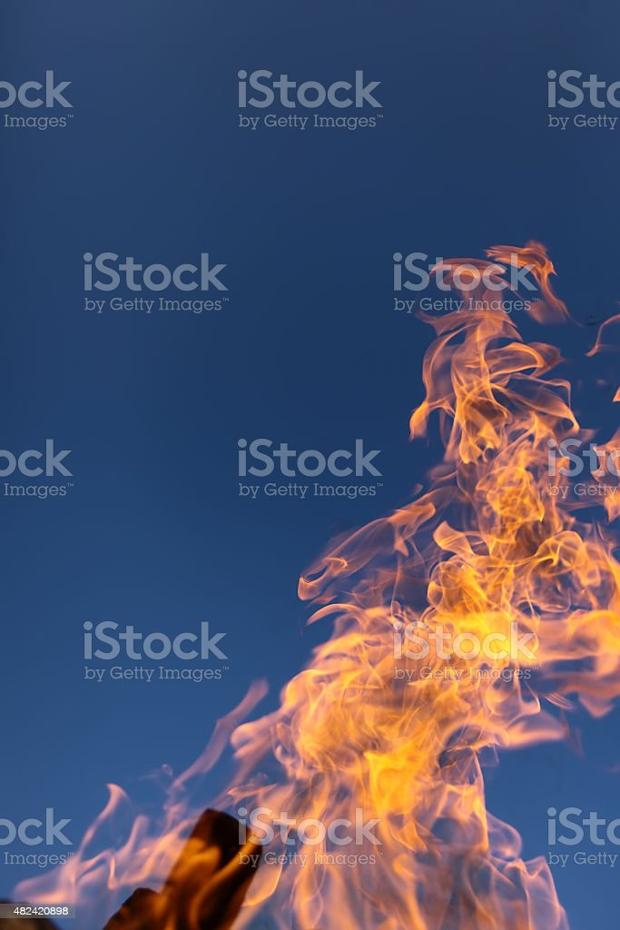 Yellow flame and blue sky stock photo