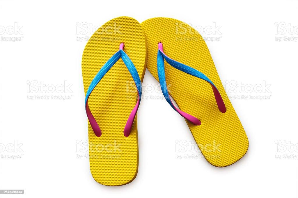 Yellow flip flops isolated on white background stock photo