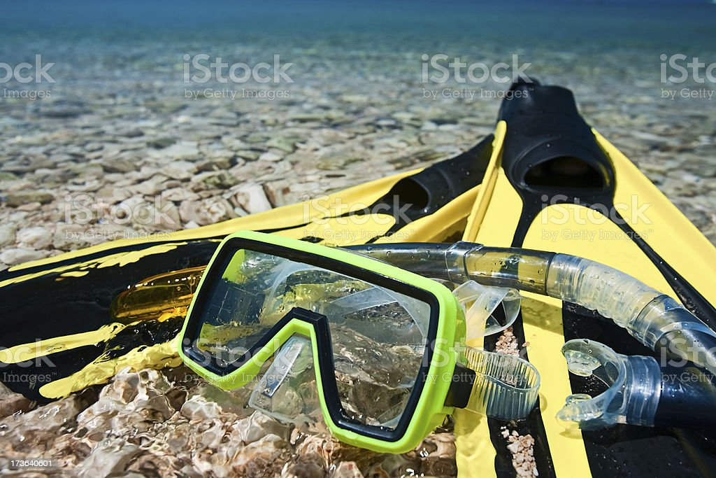 Yellow flippers, mask, snorkel and sea royalty-free stock photo