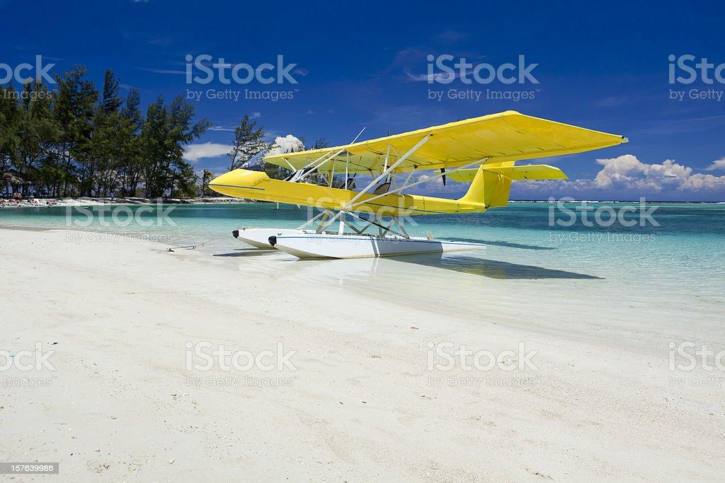 Yellow float plane on beach stock photo