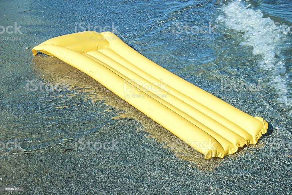Yellow Floating air mattress royalty-free stock photo