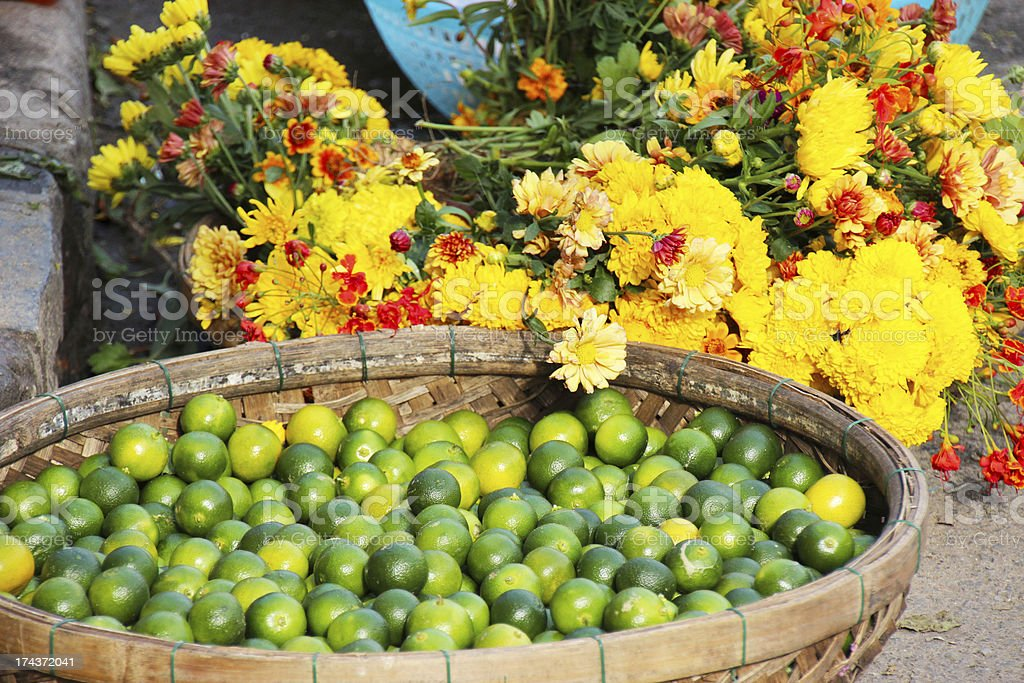 Yellow flowers and green limes royalty-free stock photo