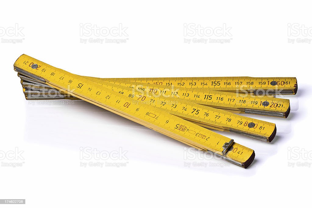 Yellow folding ruler stock photo