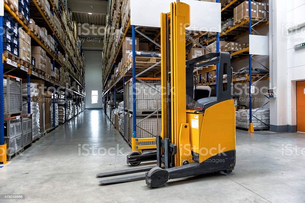 Yellow fork lift stopped in a warehouse stock photo