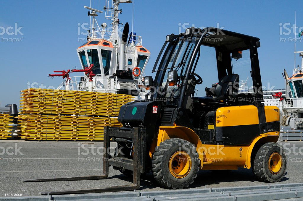 Yellow Forklift inside Harbor royalty-free stock photo
