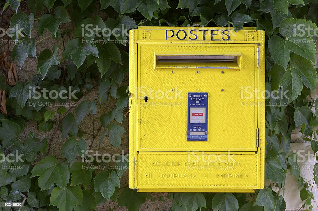 Yellow French post box on wall, chateau de chenonceau royalty-free stock photo