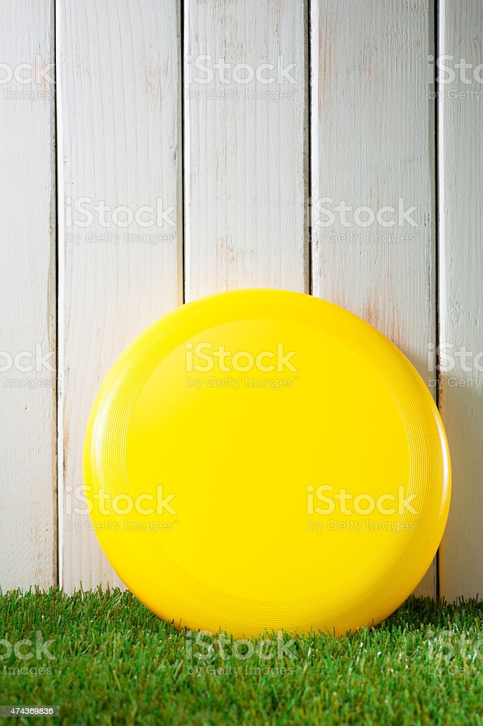 Yellow Frisbee on Green Grass stock photo
