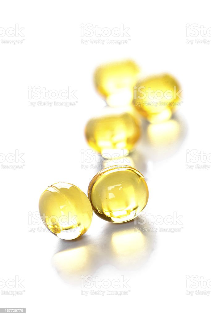 yellow gelatin pills stock photo
