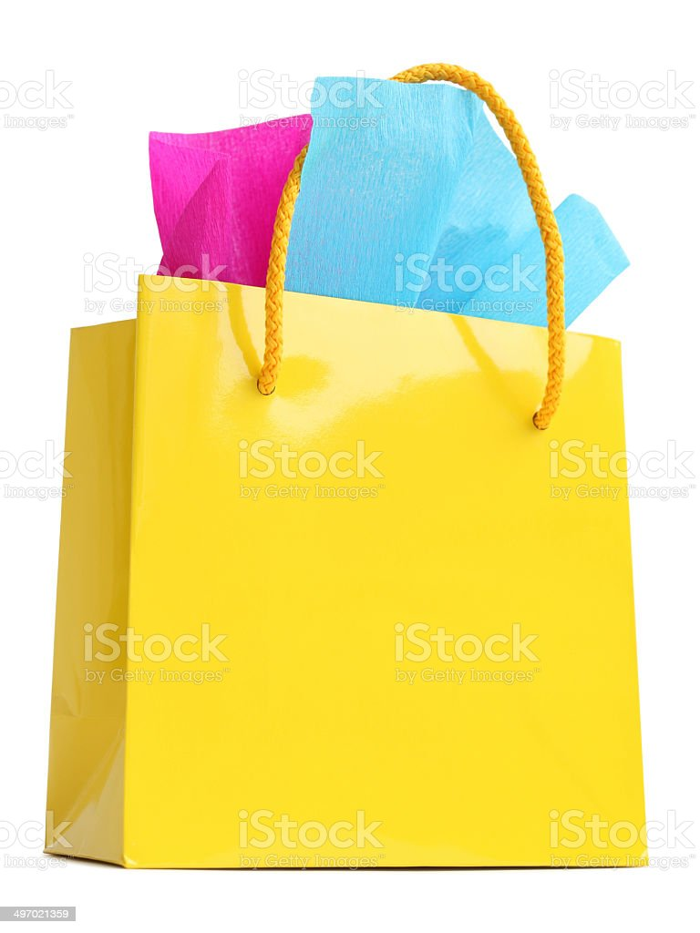 Paper bag yellow - Yellow Gift Bag Stuffed With Pink And Turquoise Tissue Paper Royalty Free Stock Photo