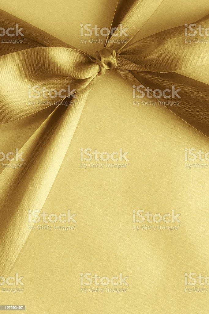 Yellow gift box with matching ribbon stock photo