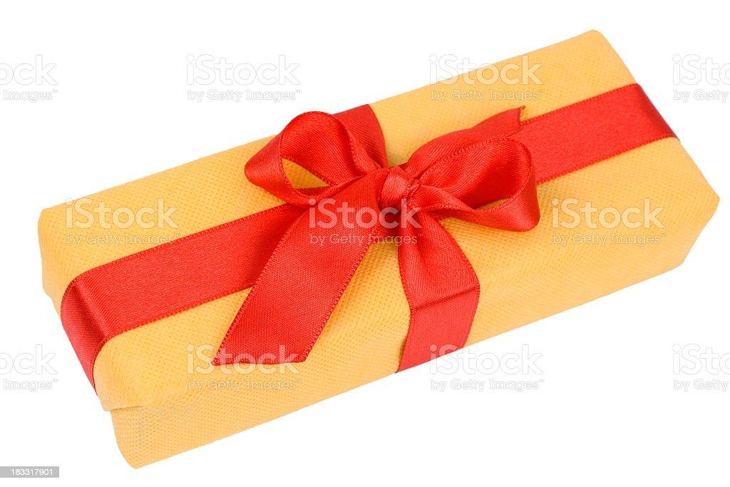 Yellow  Gift Box with red Satin Ribbon royalty-free stock photo