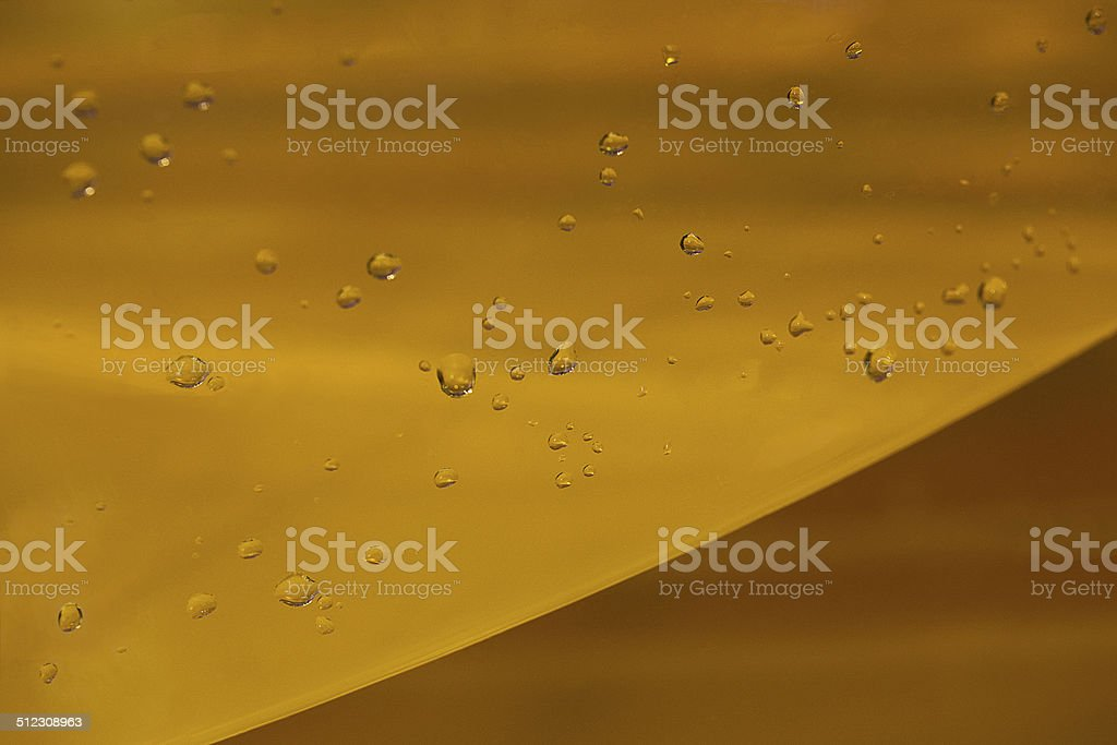 Yellow glass plate with drops of water royalty-free stock photo