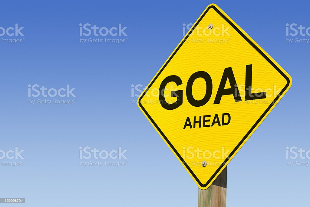 Yellow Goal Ahead street sign against blue sky royalty-free stock photo