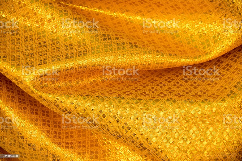 Yellow Gold Thai Fabric woven background Texture stock photo