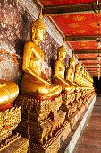Yellow golden buddha at Wat Suthat Thepwararam, Bangkok, Thailand.