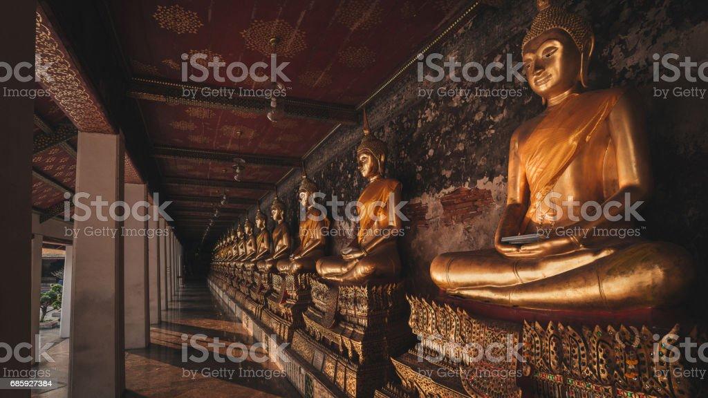 Yellow golden buddha at Wat Suthat Thepwararam in Bangkok,Thailand stock photo