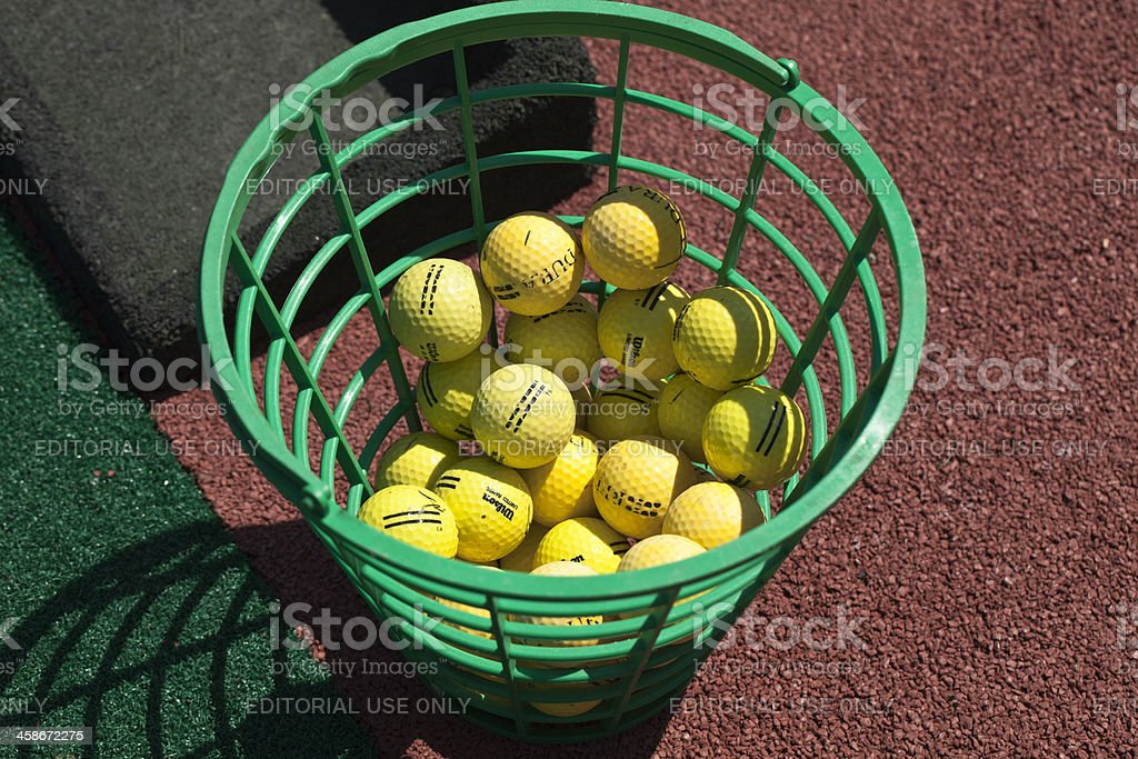 Yellow golf balls used only on a practice range. stock photo