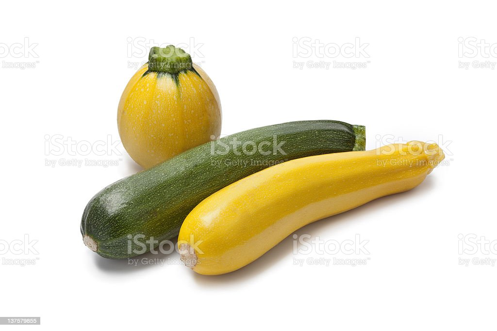 Yellow, green and round courgette stock photo