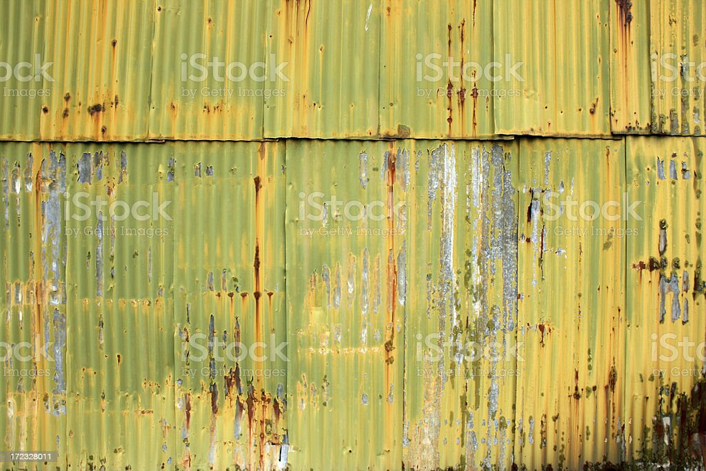 Yellow green corrugated metal warehouse background royalty-free stock photo