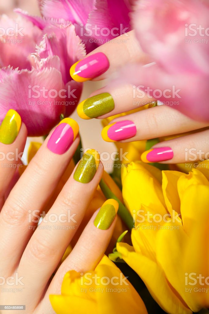 Yellow green French manicure. stock photo