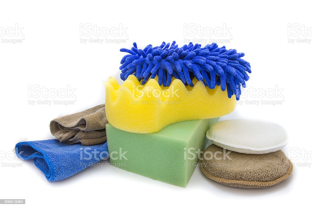 Yellow, green sponges and blue mitts for washing stock photo