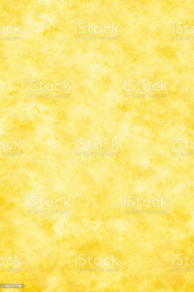 A yellow grunge paper background royalty-free stock photo