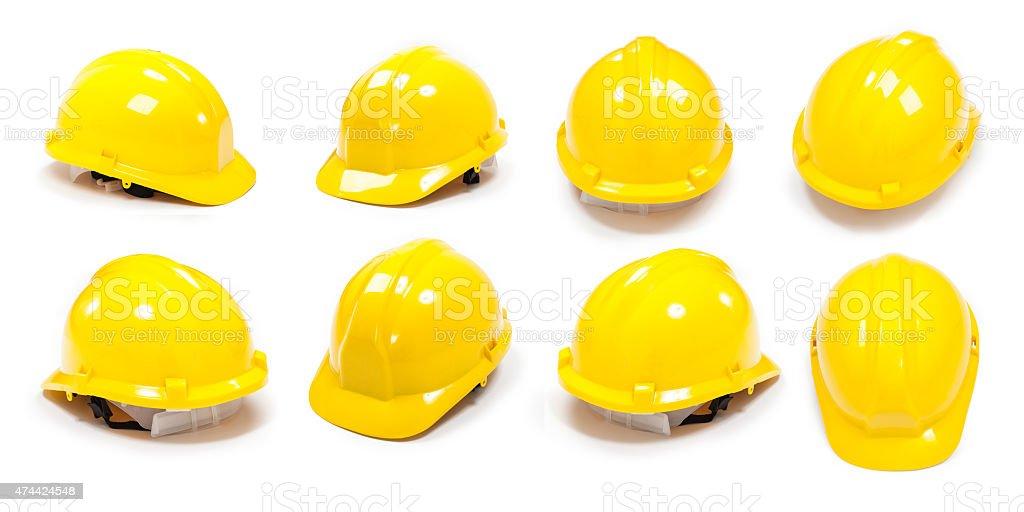 Yellow gumboot and protective helmet stock photo