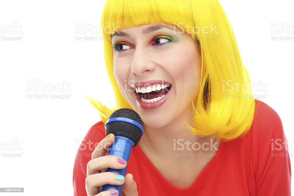 Yellow hair girl with microphone royalty-free stock photo