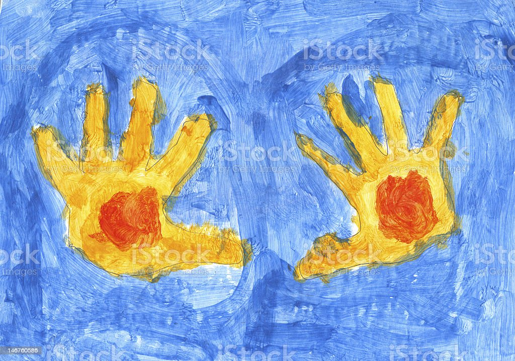 Yellow hands on the blue background stock photo