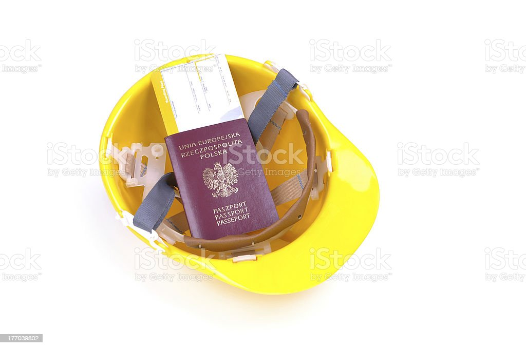 yellow hard hat with passport and boarding pass royalty-free stock photo
