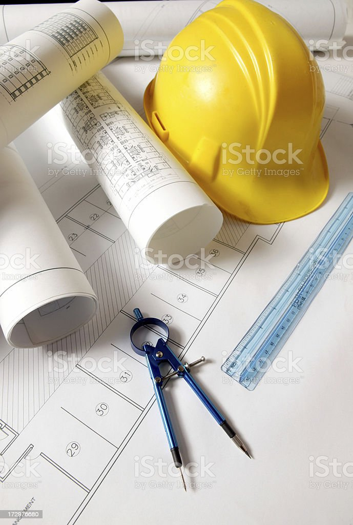 yellow hardhat and blueprint royalty-free stock photo