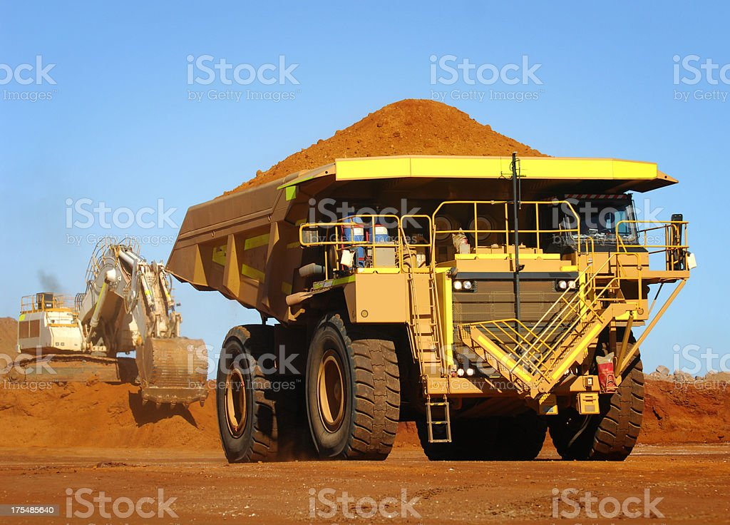Yellow haul truck loaded with dirt and ore royalty-free stock photo