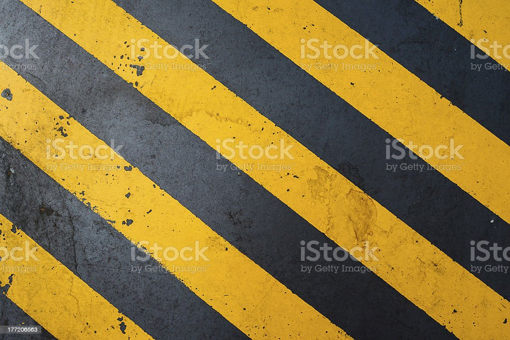 yellow hazard lines with grunge effects stock photo
