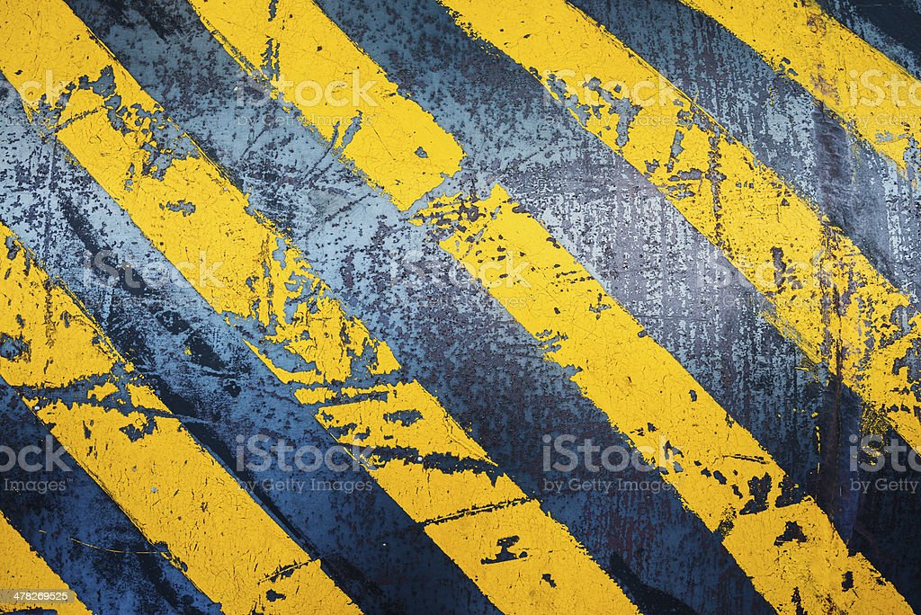 yellow hazard lines with grunge effects royalty-free stock photo