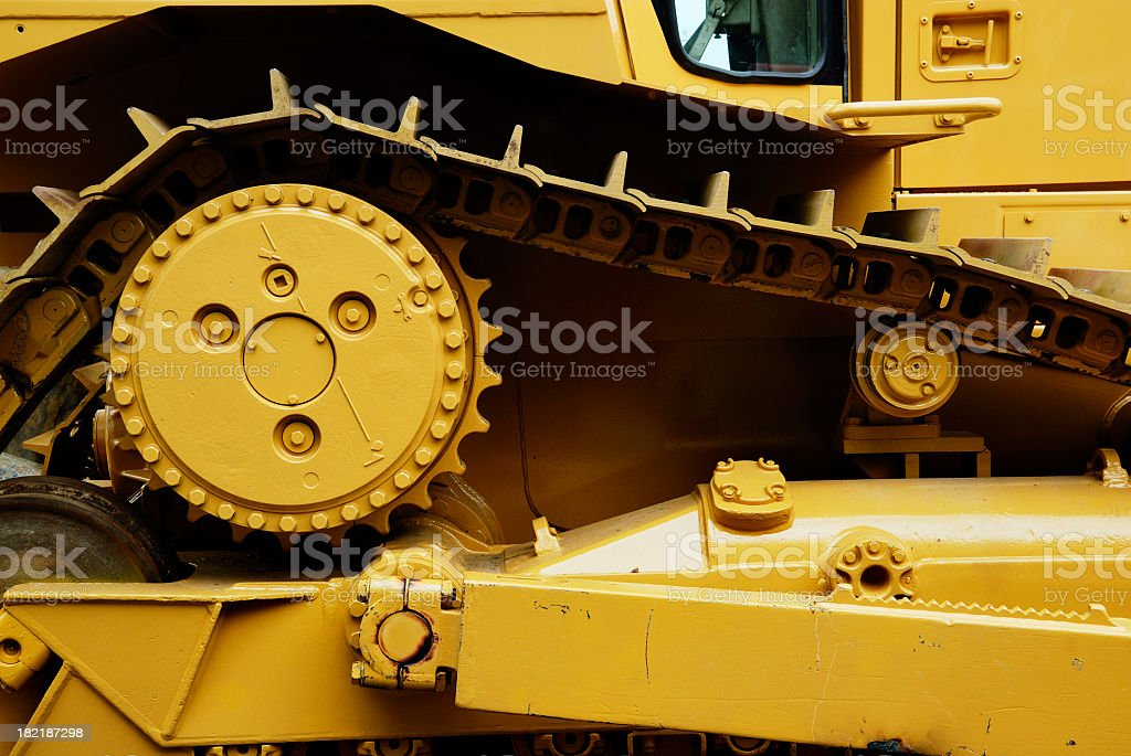 A yellow heavy machine close up stock photo
