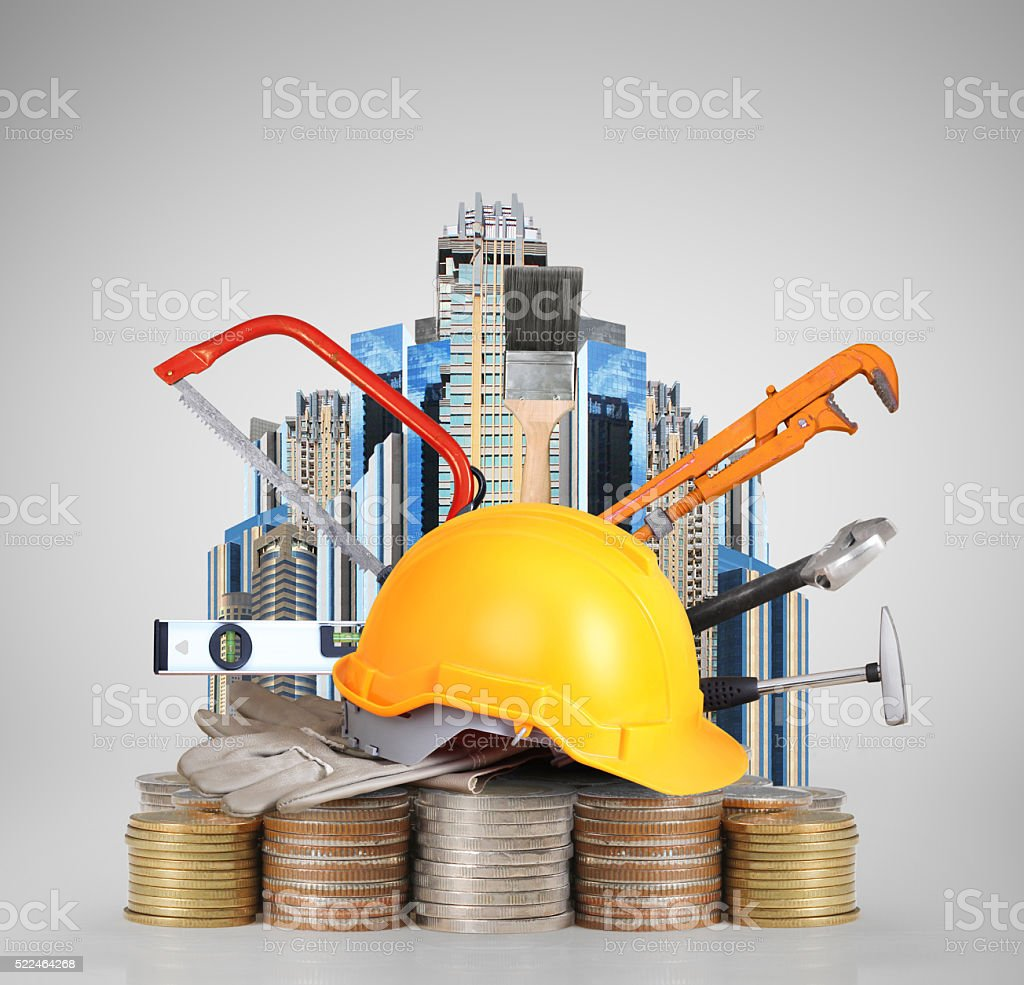 Yellow helmet plastic safety on  coins stock photo