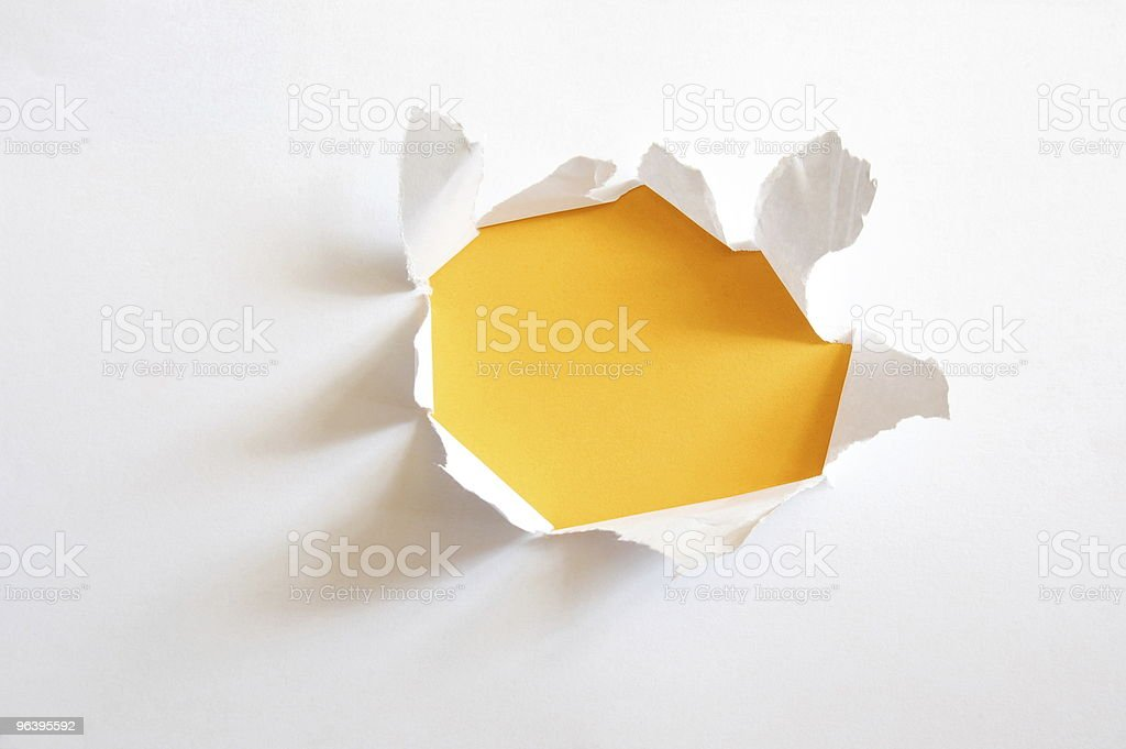 yellow hole in paper stock photo