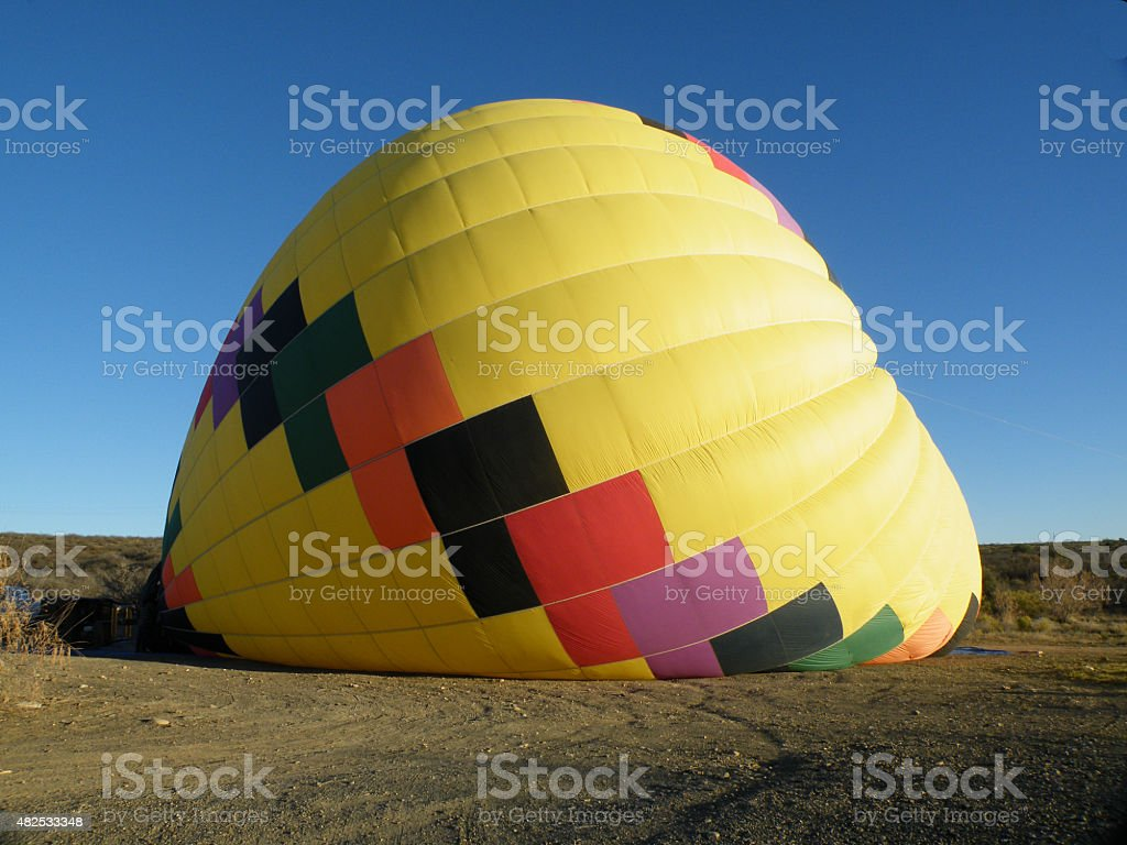 Yellow hot air balloon being inflated stock photo