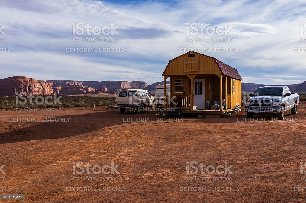 Yellow house and cars in Monument Valley (Arizona, United States) stock photo