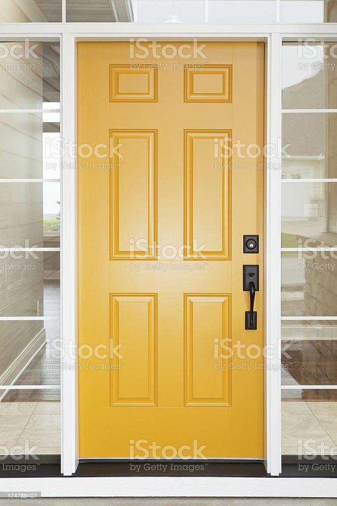 Yellow House Entry Door with Windows stock photo