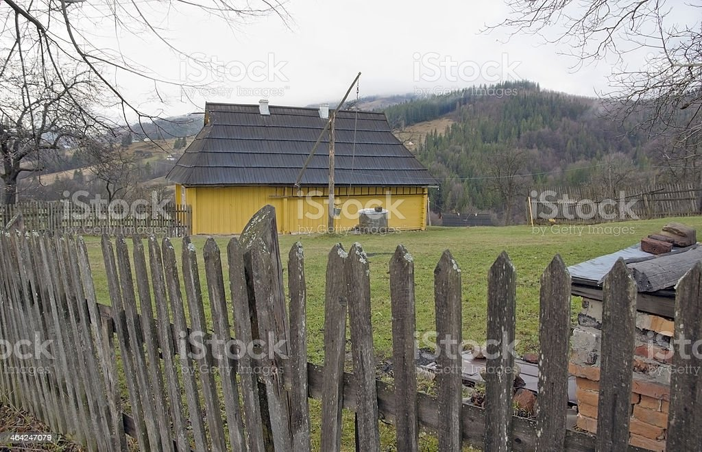 Yellow house in the country. stock photo