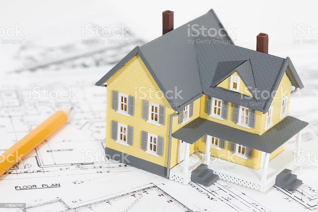 Yellow House Replica with Pencil on top Architectural Plans royalty-free stock photo