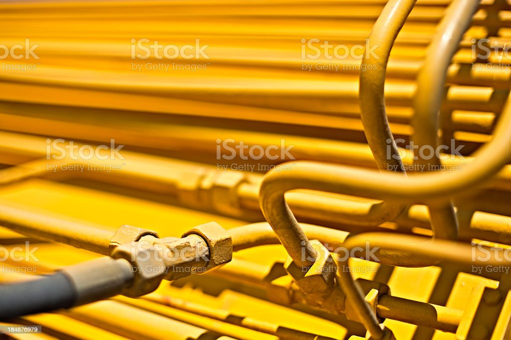 Yellow hydraulic tubes all bunched up stock photo