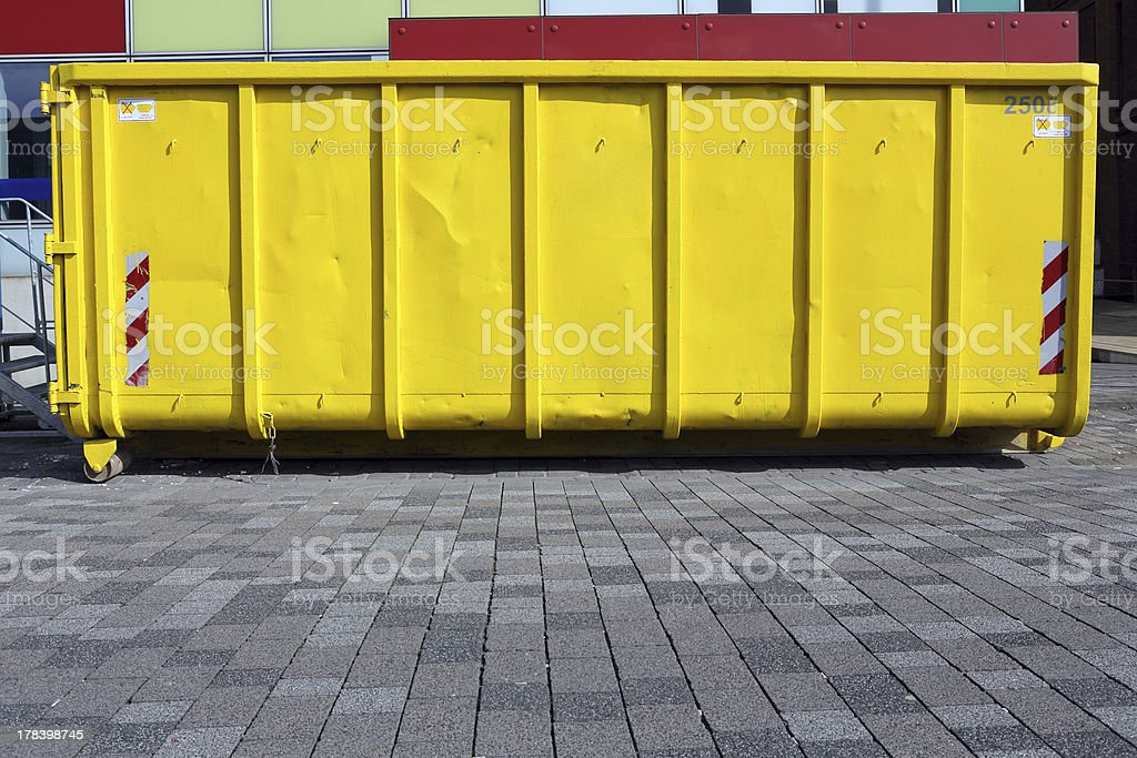 yellow industrial garbage skip stock photo