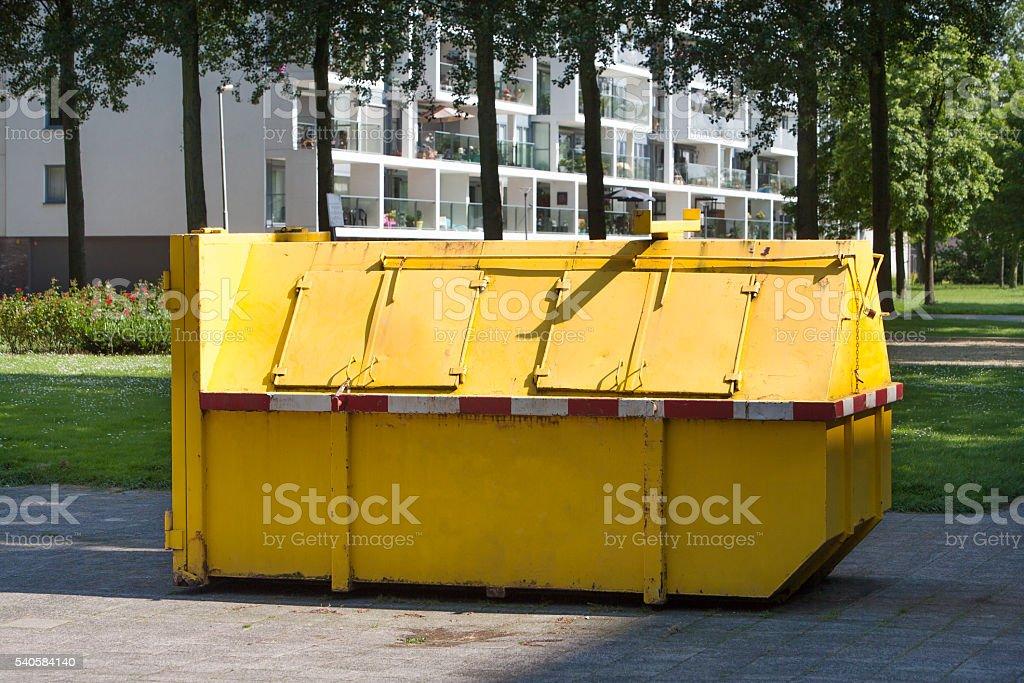 Yellow industrial garbage skip stock photo