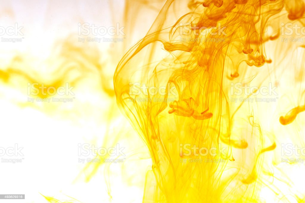 Yellow ink in water stock photo