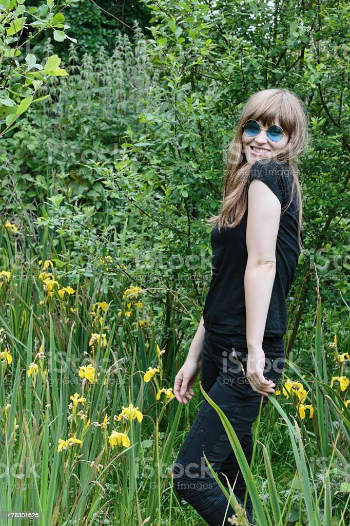 Yellow iris Latvian outdoor girl marshy background stock photo